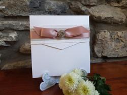 White and blush pink pocketfold invitati