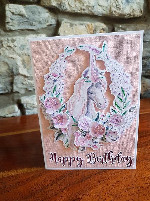 Children birthday card with unicorn