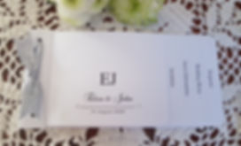 White cheque book wedding invitation wit