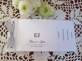 White cheque book wedding invitation wit