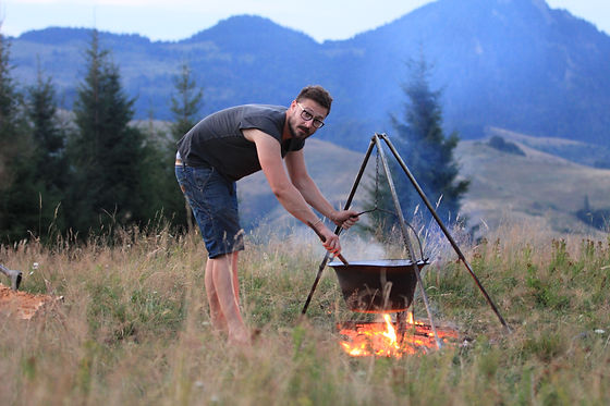 Outdoor cooking on tripod