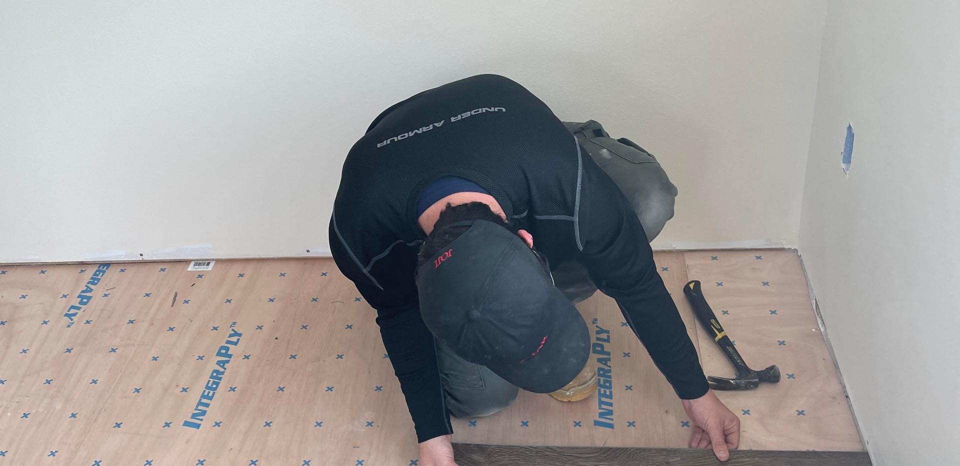 Mike installing flooring