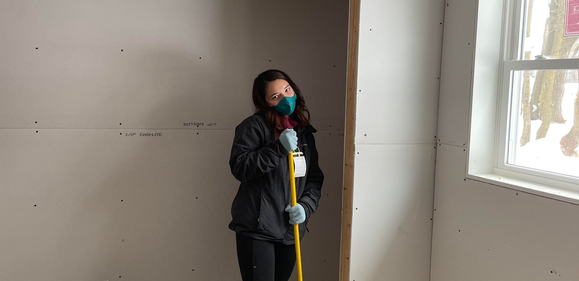 Mike's sister helping with drywall