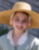 photo of pilgrim girl in big straw hat