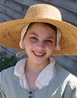 photo of pilgrim girl in big straw hat