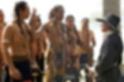 photo of native American men greeting a pilgrim man