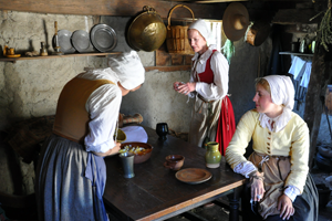 photo of pilgrim women working at a kitchen table