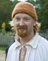 photo of pilgrim man in orange cap