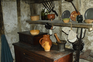 photo of pilgrim house interior with kitchen dishes pottery
