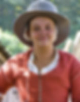 photo of pilgrim woman in gray hat and red clothing