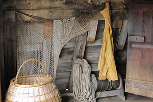 photo of Mayflower II ship interior with nets, ropes, and basket