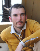 photo of pilgrim man in gold jacket