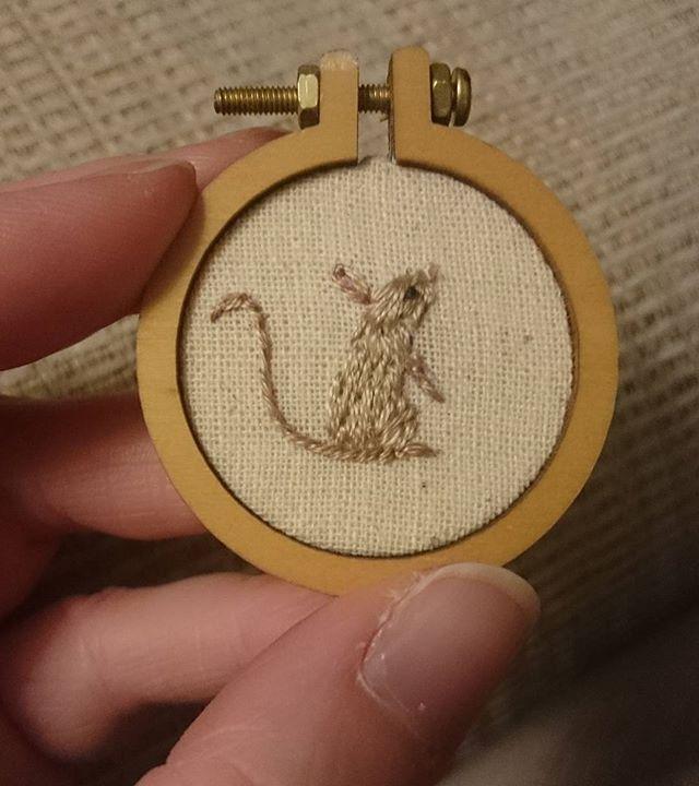 A wee teeny tiny mouse in a teeny tiny hoop