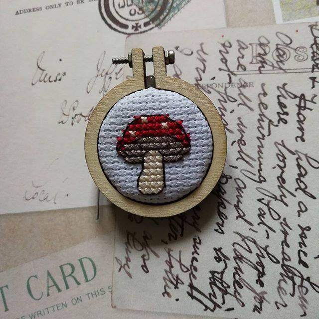 A cross stitched toadstool brooch