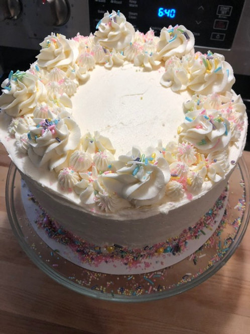 Vanilla and sprinkles layer cake