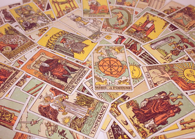 Pile of tarot cards spread out