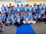 Kushindokai Students Kick in $10,008.75 for DCAFS
