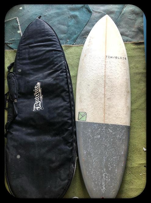 tim/slute single fin surfboard