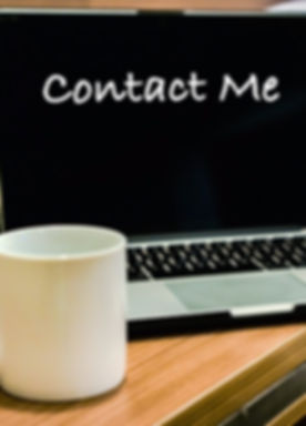CONTACT ME wording on laptop screen with bedroom interior as background.jpg