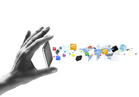 Human hand holding mobile phone and icons flying out