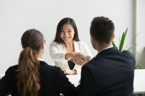 Happy millennial asian applicant getting