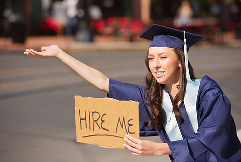 Single college graduate in gown holding