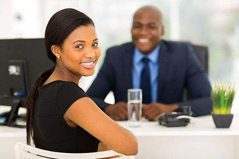 attractive african office worker looking