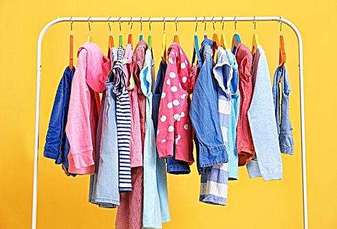 Clothes hanging on rack, closeup.jpg