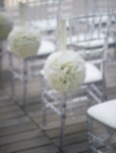 Clear chiavari chairs set up for wedding ceremony