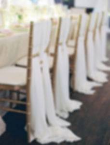 Gold chiavari chairs set up for wedding reception
