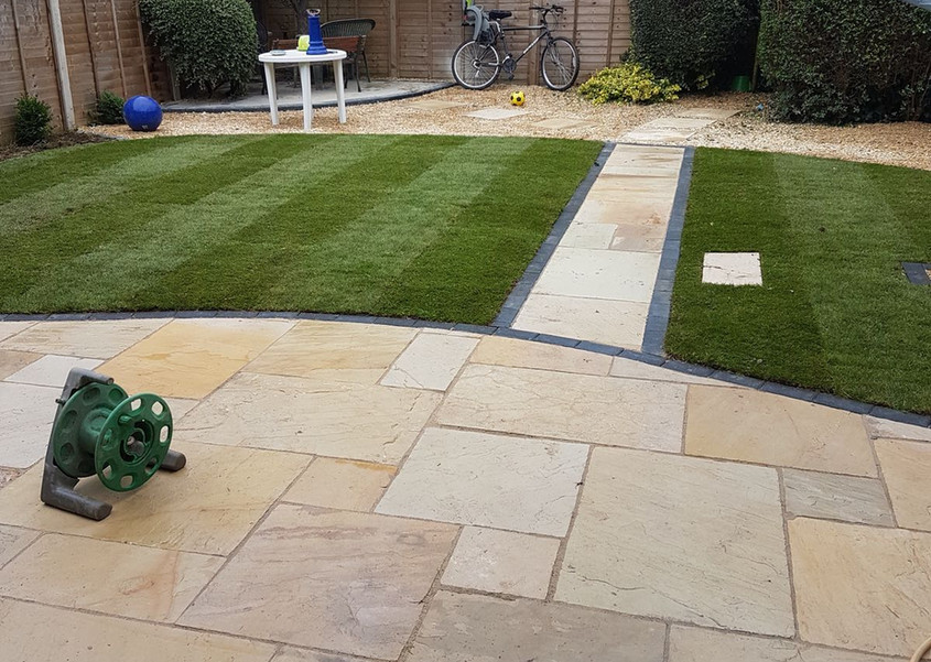 full landscaped garden patio and lawn