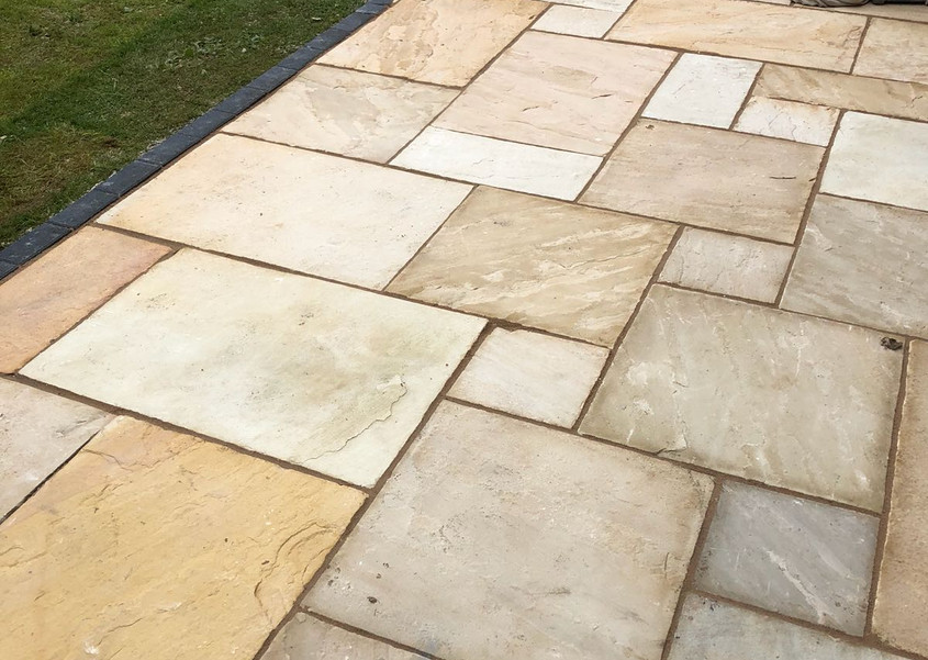 bradstone patio with charcoal boarder