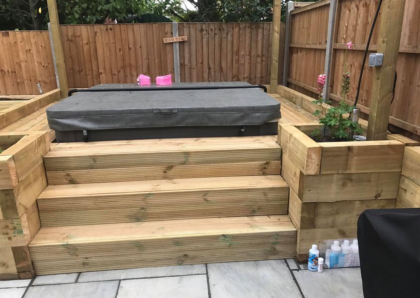 Raised sleeper area for hot tub