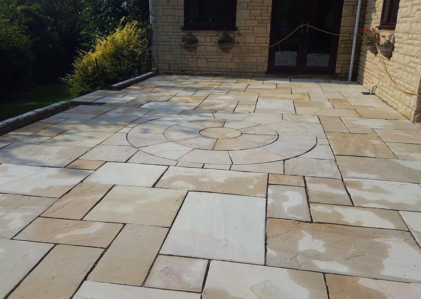 raised patio area laid with circle