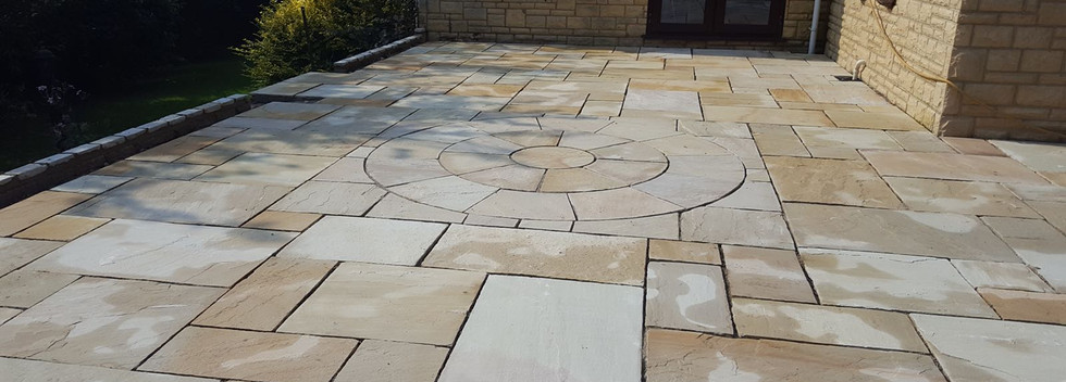raised patio area laid with circle