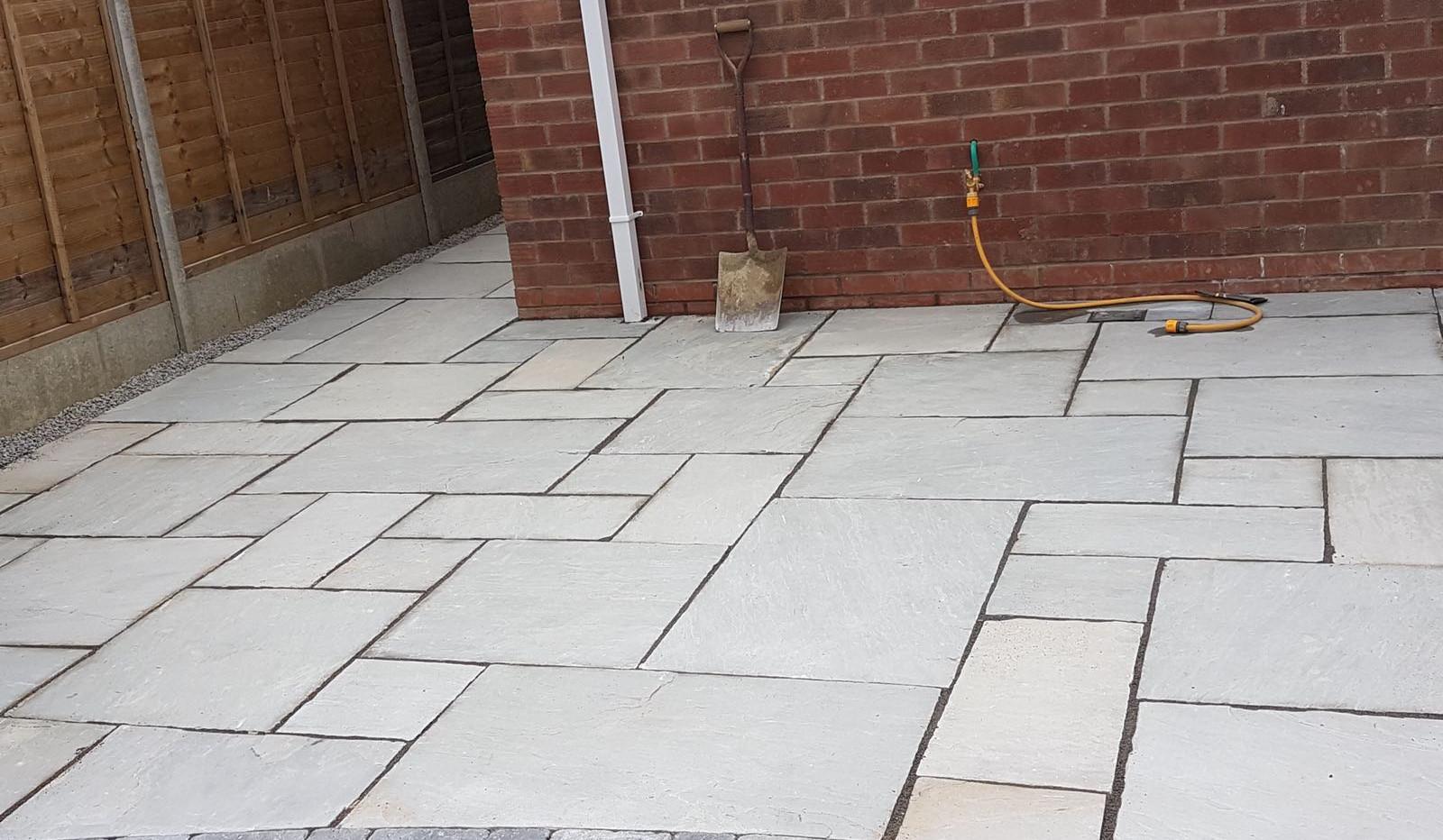 grey patio with brick boarder