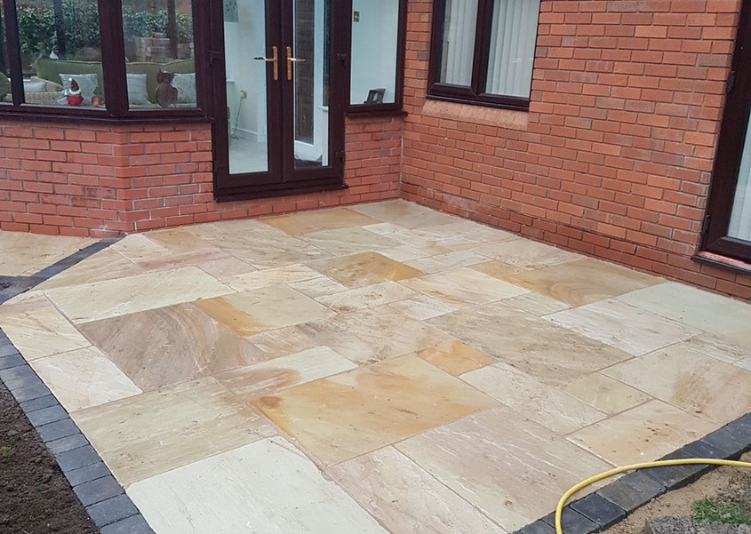 fossil mint patio with block paved boarder