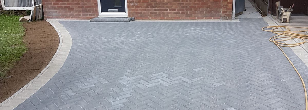 charcoal block paved drive with grey boarder