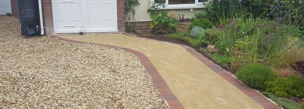 buff block paved patio and gravel driveway