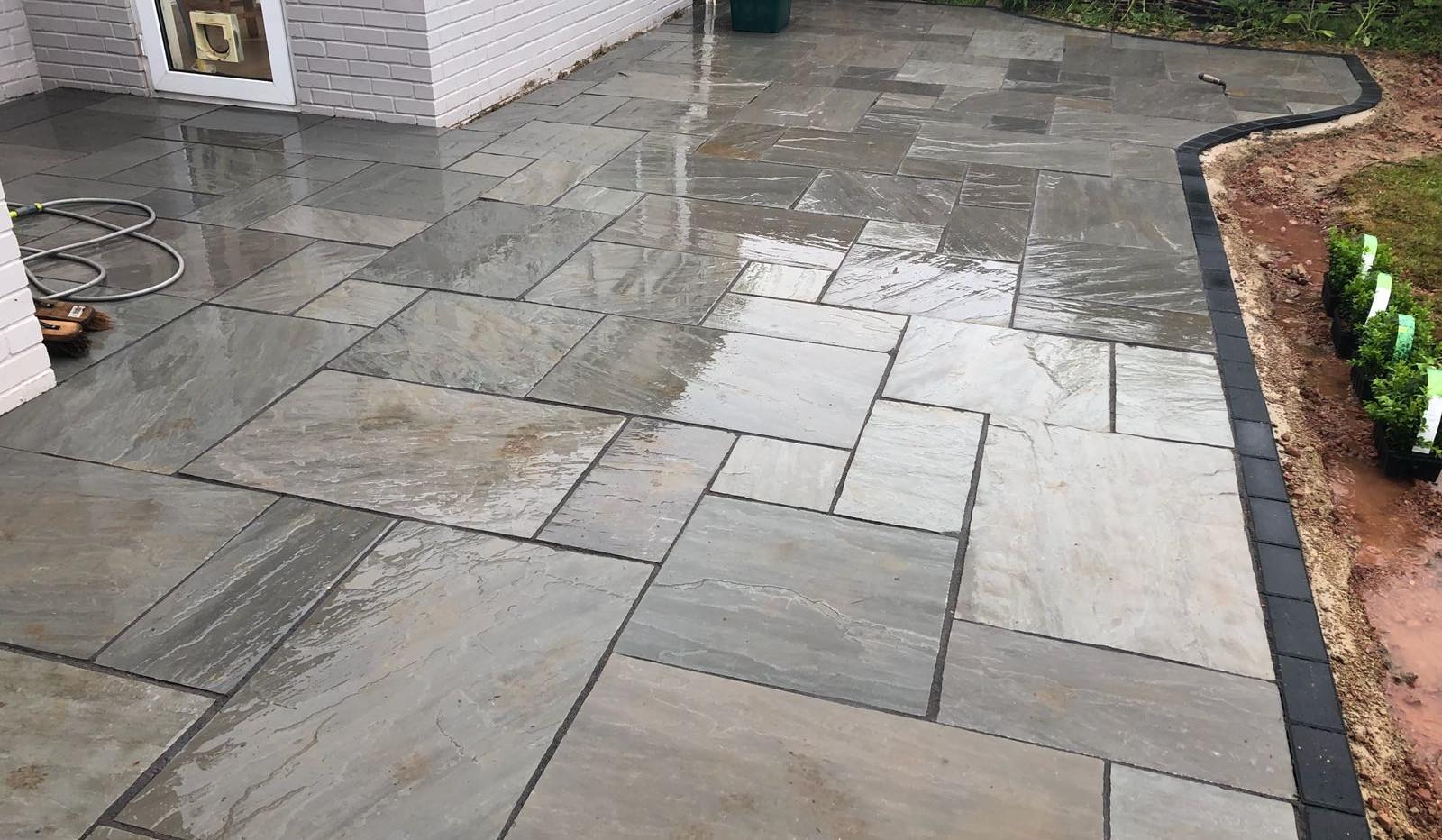 silver grey sandstone patio laid