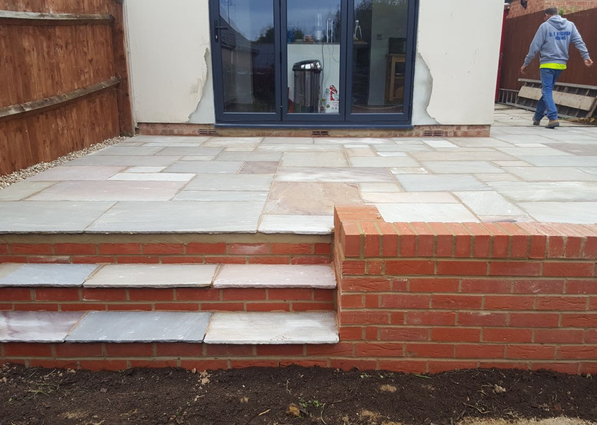 Raised patio with retaining wall and steps
