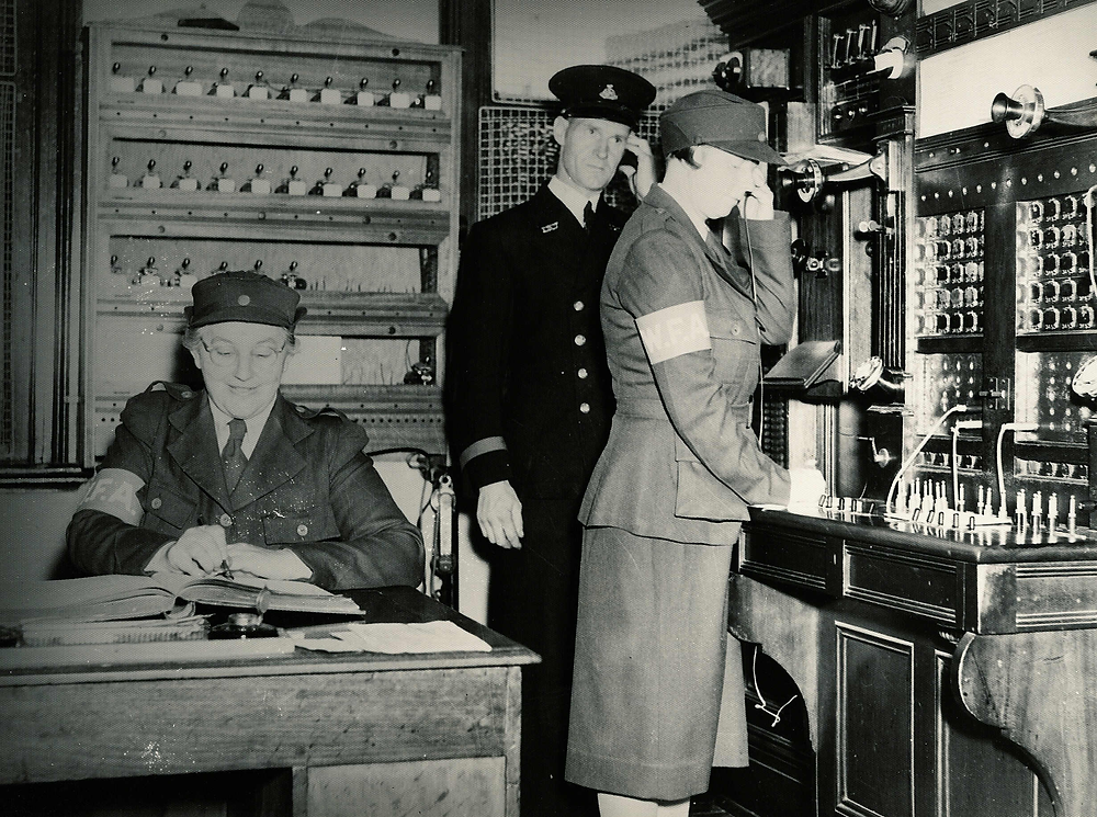 Women from the Women's Fire Auxiliary were expected to undertake watchroom duties at their local fire station at least one night each week as shown here, c. 1944.