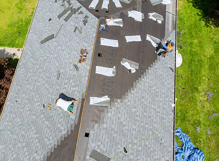 roofer-working-on-replacement-asphalt