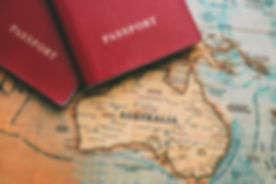Two passports on map. Travel to Australi
