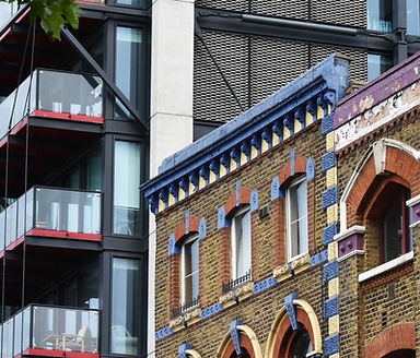 Condition Surveys | Old building juxtaposed next to a new building