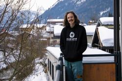 Man in hoodie on balcony