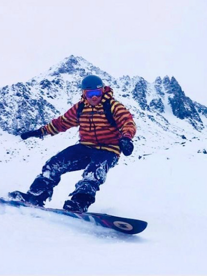 Snacknud riding the PowDaze_edited.png