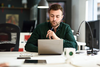 young-man-studying-with-laptop-computer-