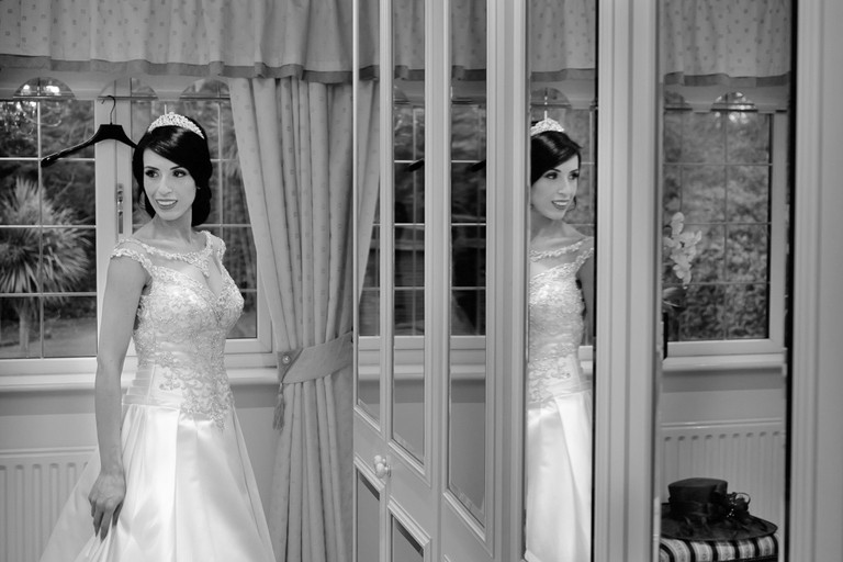 bride in mirrors at christmas wedding