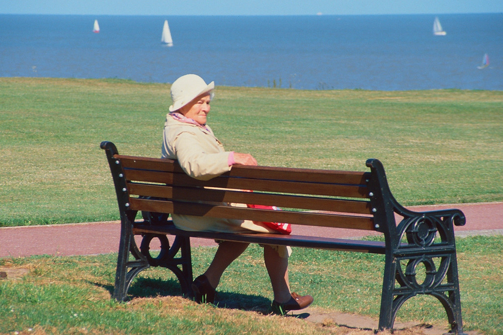 Lady on bench at Great British seaside